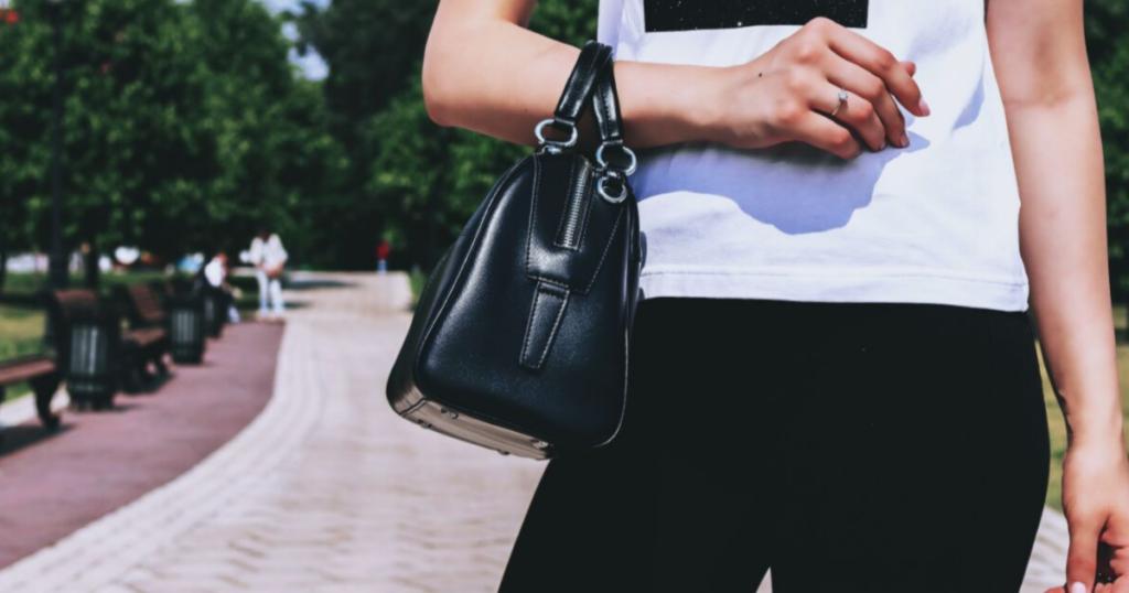 a girl holdin a bag
